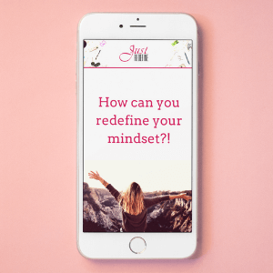 cell phone with a cover of a workbook titled how can you redefine your mindset by Alicja Ciesielska
